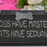 Dogs Have Masters Cats Have Servants Sign