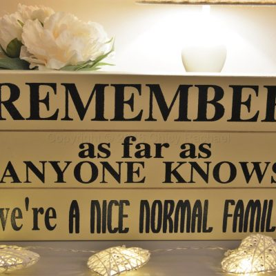 Remember We Are A Nice Normal Family Sign