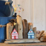 Double Beach Huts On Driftwood