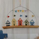 Five Coloured Beach Huts On Driftwood 1