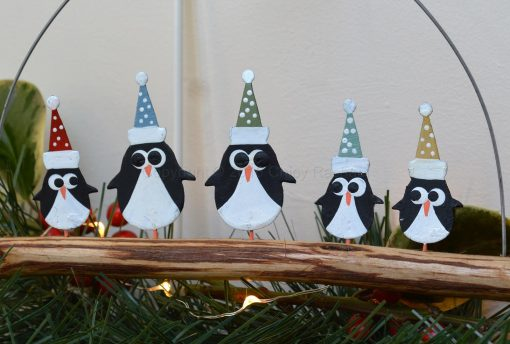 Penguins In Spotty Hats On Driftwood 1