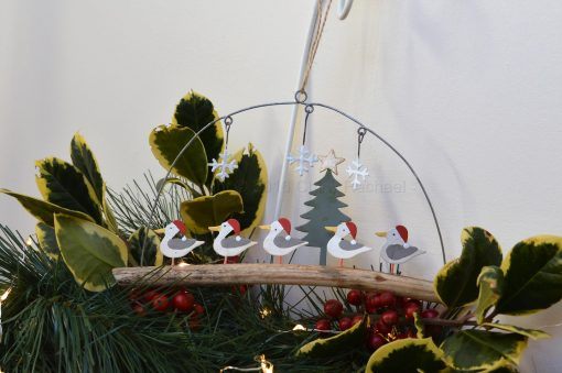Seagulls In Christmas Hats On Driftwood