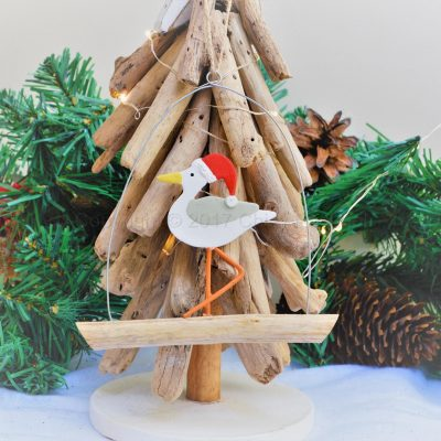 Seagull In Santa Hat On Driftwood 2