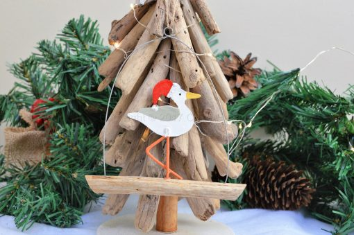 Seagull In Santa Hat On Driftwood